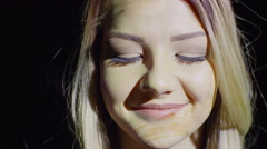 Close up shot of projections of coins on woman's face / Cedar Hills, Utah, Stock Footage
