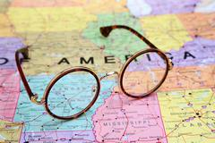 Glasses on a map of USA - Arkansas - stock photo