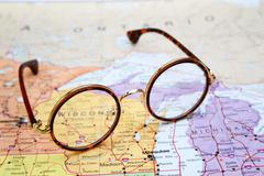 Glasses on a map of USA - Wisconsin - stock photo