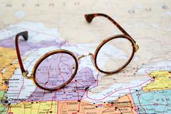 Glasses on a map of USA - Michigan - stock photo