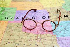 Glasses on a map of USA - Oklahoma Stock Photos