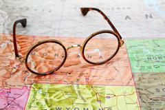 Glasses on a map of USA - Montana Stock Photos