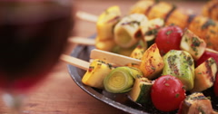 Delicious selection of grilled vegetable kebabs, corn and asparagus - stock footage