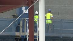 Construction workers on access platform. Stock Footage