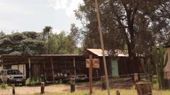 Ministry of lands survey office, Maralal, Samburu, Kenya, Africa, pan left Stock Footage