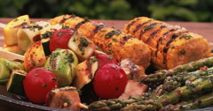 Grilled vegetable kebabs with corn and asparagus Stock Footage