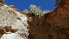 Icicles melting on the natural bridge in Tonto Bridge State Park in Arizona Stock Footage