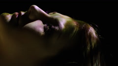 Close up panning slow motion shot of projections on woman's face / Cedar Hills, - stock footage