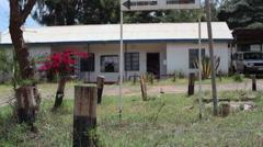 Ministry of lands survey office, Maralal, Samburu, Kenya, Africa, tilt up Stock Footage