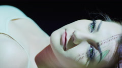 Close up shot of money projections on woman's face / Cedar Hills, Utah, United Stock Footage