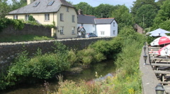 River Exe at Exford Village in Exmoor National Park in Somerset England Stock Footage