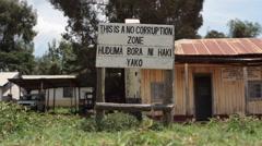 No corruption zone sign in swahili, Samburu, Kenya, Africa Stock Footage