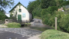 Winn Brook Ford in Winsford Village Somerset Stock Footage