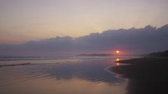 Wide shot of sunset sky over beach ocean / Esterillos, Puntarenas, Costa Rica Stock Footage
