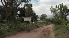 Road leading to district agriculture office, Maralal, Samburu, Kenya, Africa Stock Footage