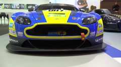 4k Aston Martin GT Racing car at motorshow indoor exhibition Stock Footage