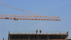 Construction site Timelapse of workers and a crane Stock Footage