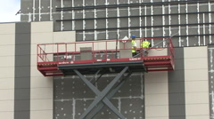 Construction workers on elevated platform. Stock Footage