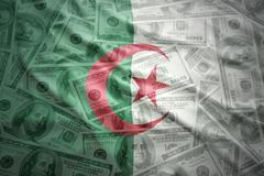colorful waving algerian flag on a american dollar money background - stock photo