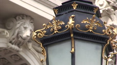 Street lamp decorated with golden metal in front of Lviv opera Stock Footage