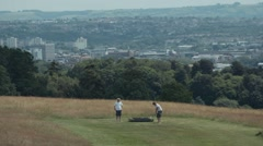 Man Swings Golf Club on City Golf Course - Super Slow Motion, High Frame Rate Stock Footage