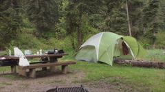 Camping near the rstream Stock Footage