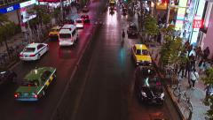 Traffic passes under a bridge outside Shinjuku station Stock Footage