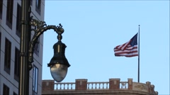 American flag flying on building. - stock footage