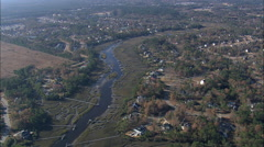 AERIAL United States-Flight Over Houses And Jetties Alomg Toomer Creek - stock footage