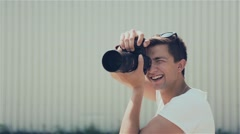 Young photographer taking pictures Stock Footage