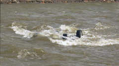 Vehicle Upside Down in River Stock Footage