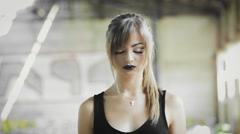 Girl with black lips, looks up at the camera Stock Footage