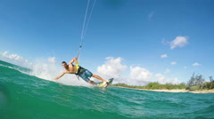 Young Man Kitesurfing in Ocean Stock Footage