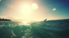 Young Man Kitesurfing in Ocean at Sunset. Stock Footage