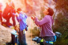 belayer with the rope and carabines - stock photo