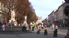 View to Market Square of Lviv, married couple walk by Stock Footage