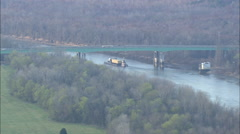 AERIAL United States-Tug And Barge Under Bridge On River Tombigbee Stock Footage