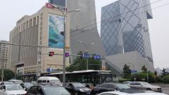 Road crossing with a view of the headquarters CCTV, Beijing Stock Footage