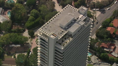AERIAL United States-Flight Over Appartment Block With Workman On Roof Stock Footage