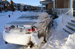 Car after snowstorm - stock photo
