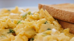 Fried eggs and mixed with scallion on plate slow panning 4K 3840X2160 UltraHD Stock Footage
