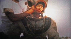 1952: Man testing out new deep sea diver suit in the Tennessee River. Stock Footage