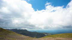 Clouds moving over mountain and forest:time lapse Stock Footage