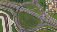 AERIAL: Four highways joining huge roundabout junction - stock footage
