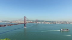 Aerial from the 25 Abril bridge and the river Tejo in Lisbon Portugal Stock Footage