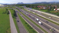 AERIAL: Cars and trucks driving on multi-lane highway - stock footage