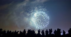 Crowd of people silhouettes watching fireworks display show on July 4th. 4K UHD Stock Footage