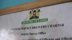 Ministry of lands poster and prices, Kenya, Africa, close up, tilt down Stock Footage