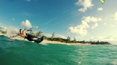Young Man Kitesurfing in Ocean Stock Footage
