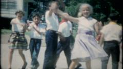 2308 - children square dance in school competition - vintage film home movie Stock Footage